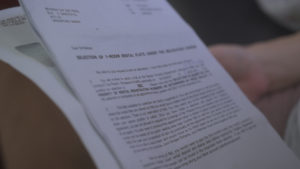 Mdm Tay reads a HDB letter